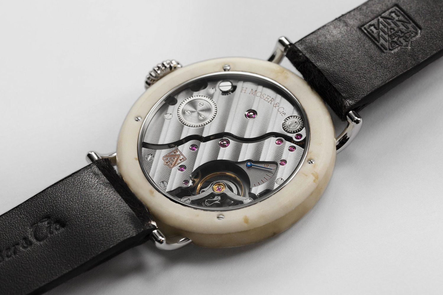The case of the Swiss Mad Watch is actual Swiss cheese combined with resin to create a special polymer.